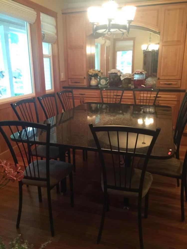 Custom made granite top dining room table with wrought iron for Custom made marble dining tables