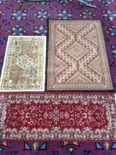 Set of three like new rugs - various sizes and styles