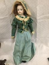 19 â??inch doll marked Bru Jne W/cloth body doll is reproduction
