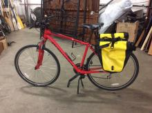Specialized Crosstrail 24-speed bicycle w/ a pair of Ortlieb waterproof saddlebags.