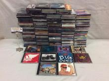 Approx 180 cds from mixed genres - classic rock, pop + - Aerosmith, Eurythmics, and more see pics