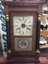 Antique New Haven clock co. time/strike wall clock with pillar case & frosted/painted glass front