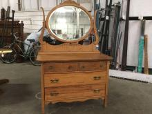 Antique Americana serpentine front vanity dresser with carved oval mirror - see pics
