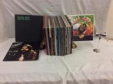 Approximately 60 classic rock albums, peter tosh, bob seger, peter tosh, etc