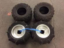 set of 4 quad tires new, 2 with chrome rims