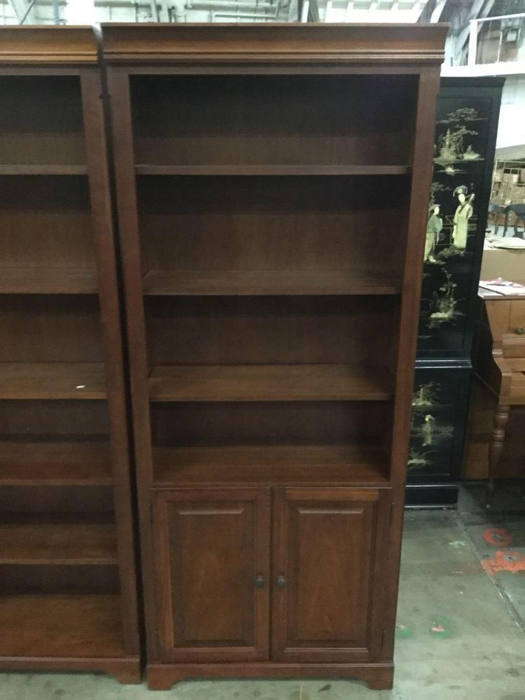 Set of two matching dark wood stained bookcases for Furniture auctions uk