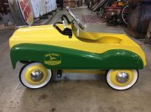 A John Deere customer care service pedal car