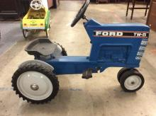 blue Ford TW-5 pedal tractor by Ertl