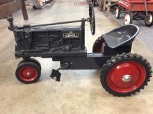 A Farmall F-20 pedal tractor