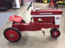 A McCormick Farmall 560 pedal tractor