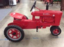 A McCormick Farmall super H pedal tractor