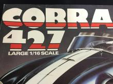 1:16 scale Cobra 427 plastic model kit by MPC, and a