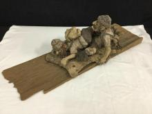 Vintage clay & wood hand made wall art piece depicting two climbers/travelers