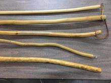 selection of five natural wood canes