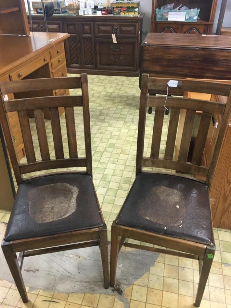 Set of two vintage wood and pleather chairs as is for Furniture auctions uk