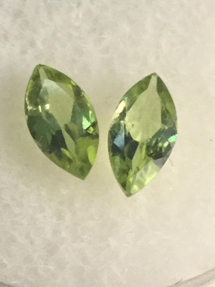 2 peridot gemstones. .90 ft. Ea. 8 X 4 mm