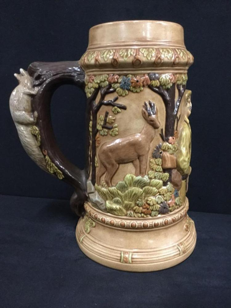 Huge handcrafted German style beer Stein with detailed forest/animal scene