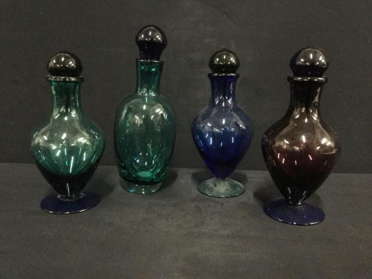 Set of four art glass perfume bottles in various colors