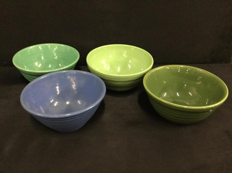 Set of four antique green and blue earthenware bowls