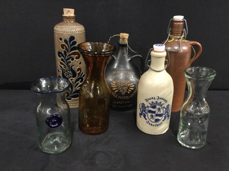 Selection of vintage salt glazed crockery bottles and glass milk bottles