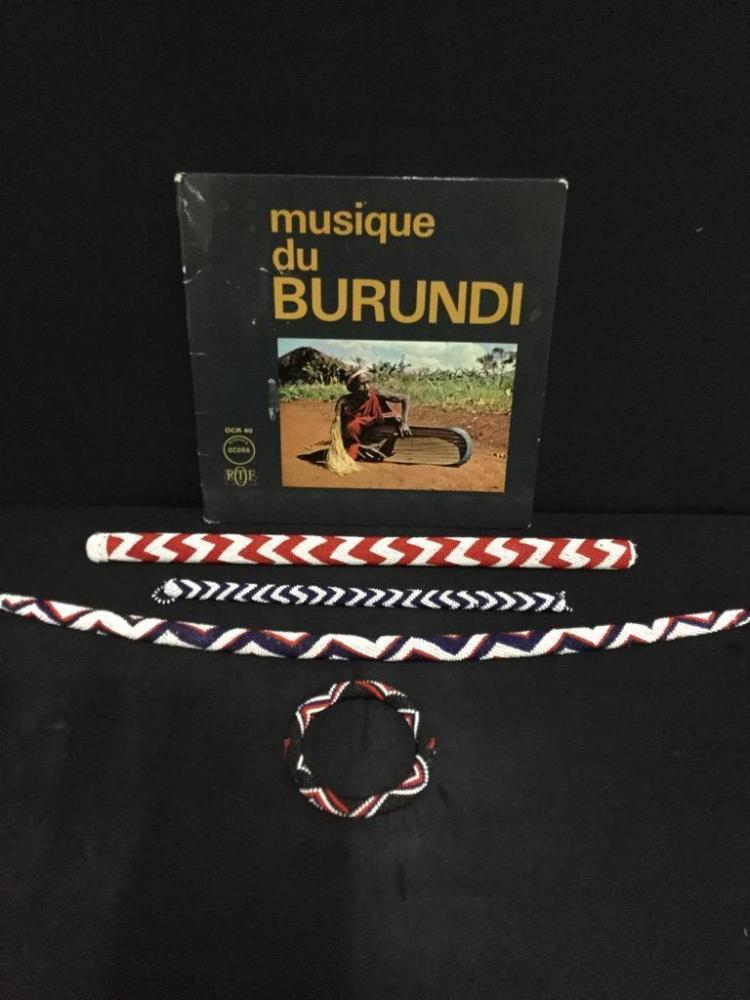 African Bead work bracelet and music sticks w/ album