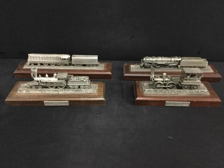 Set of 4 pewter locomotives on wooden display - most in good cond