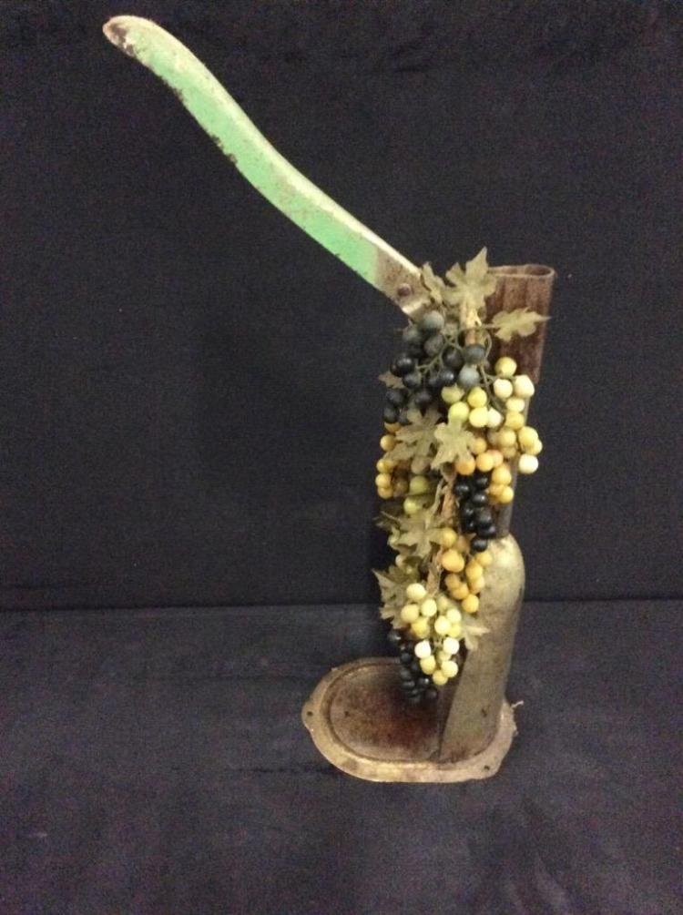 Antique Wine corker with faux foliage