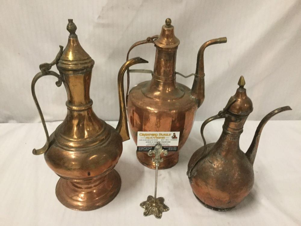 Lot 4: Collection of 3 antique hammered single handled copper ewers