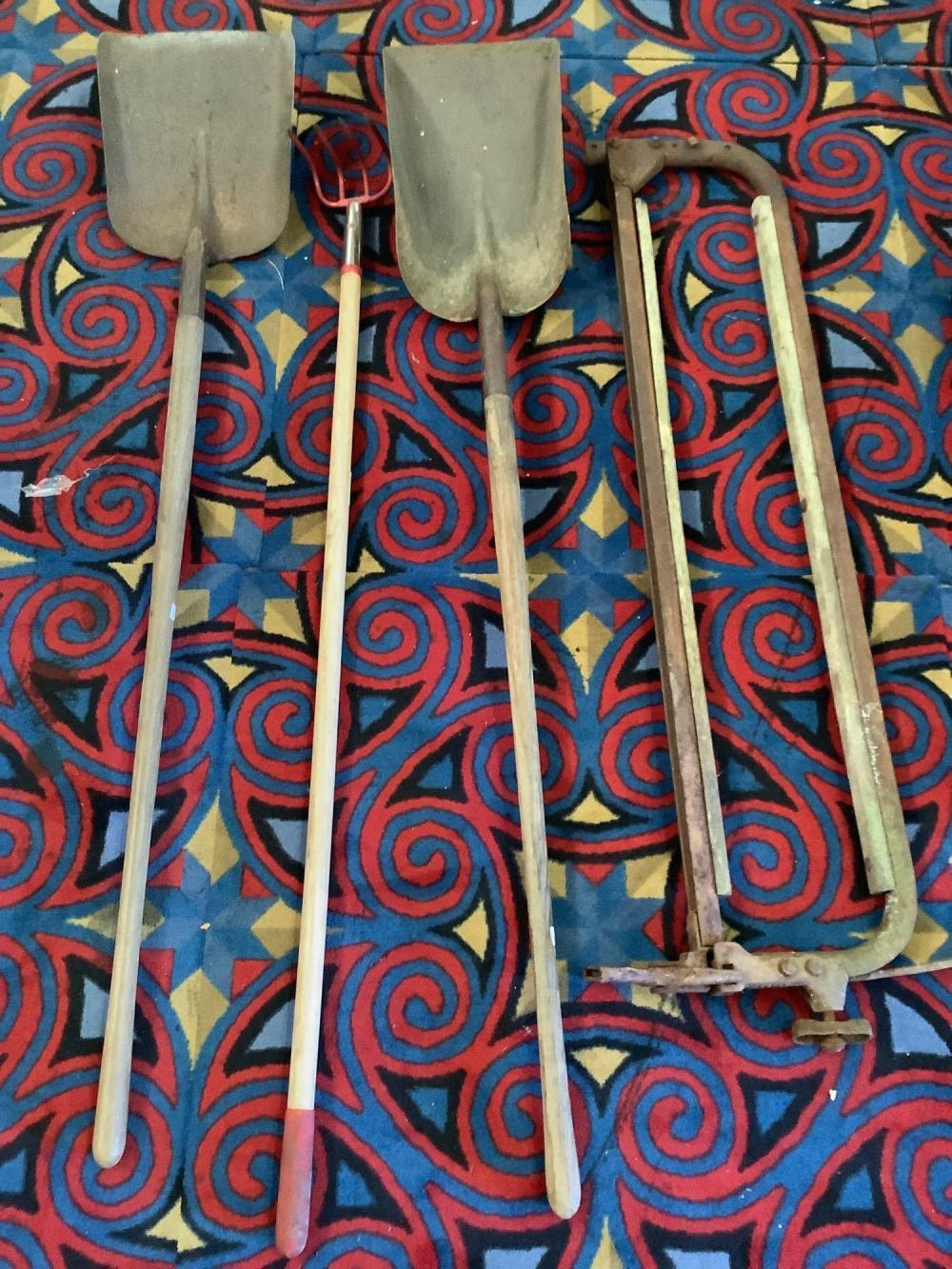 Lot 7: Vintage wood handle yard tools, axe heads, Seymour MFG. wheelbarrow, vice grip, shovels, rake etc