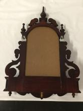 Lot 9: Antique renaissance revival style carved wall mirror with shelf and 2 small drawers