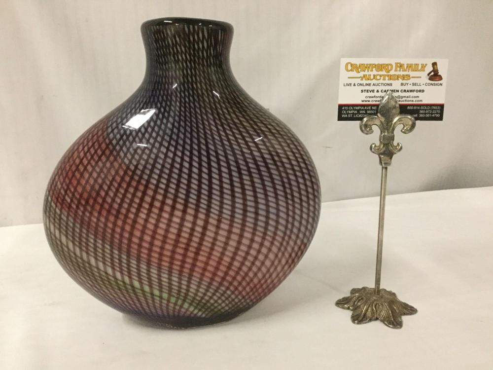 Studio art glass vase with a multicolored base and optical twisted cane design