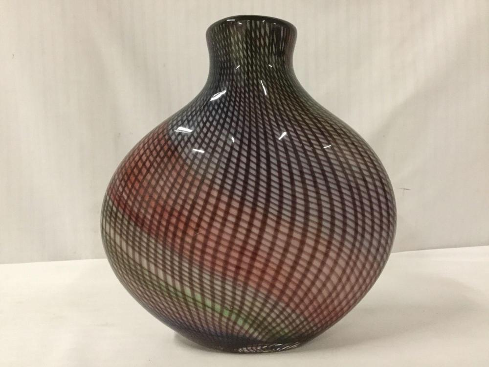 Lot 22: Studio art glass vase with a multicolored base and optical twisted cane design