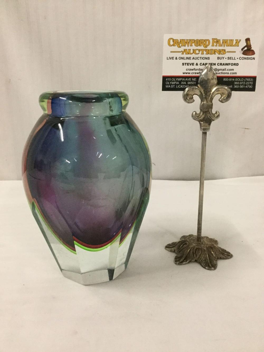 Lot 21: Cut glass multicolor vase w/ an oviod body ending on a tapered base - artist unknown