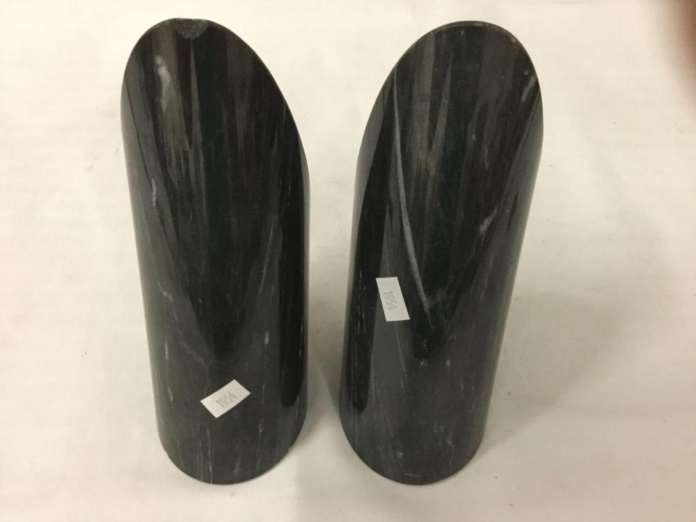 Lot 25: Pair of cut and polished tapered stone bookends, one has chip