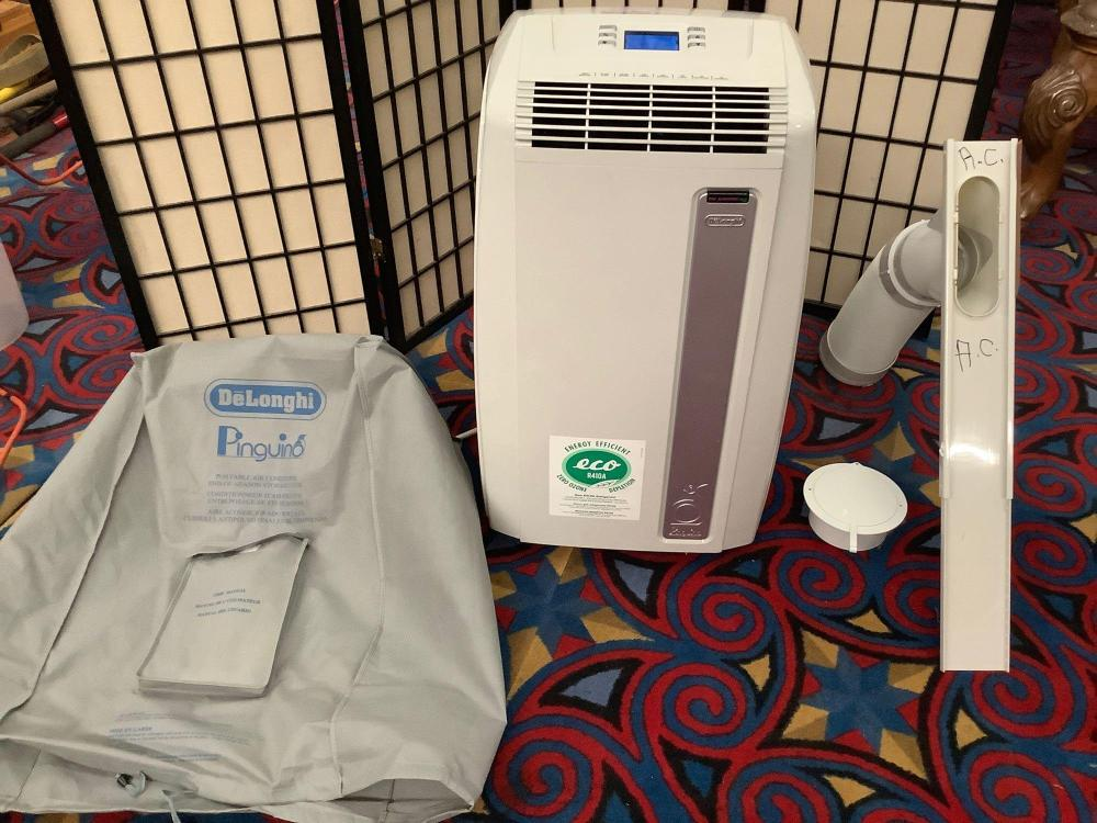 Lot 46: Delonghi - Pinguino air conditioner with remote control, owners manual, cover & more