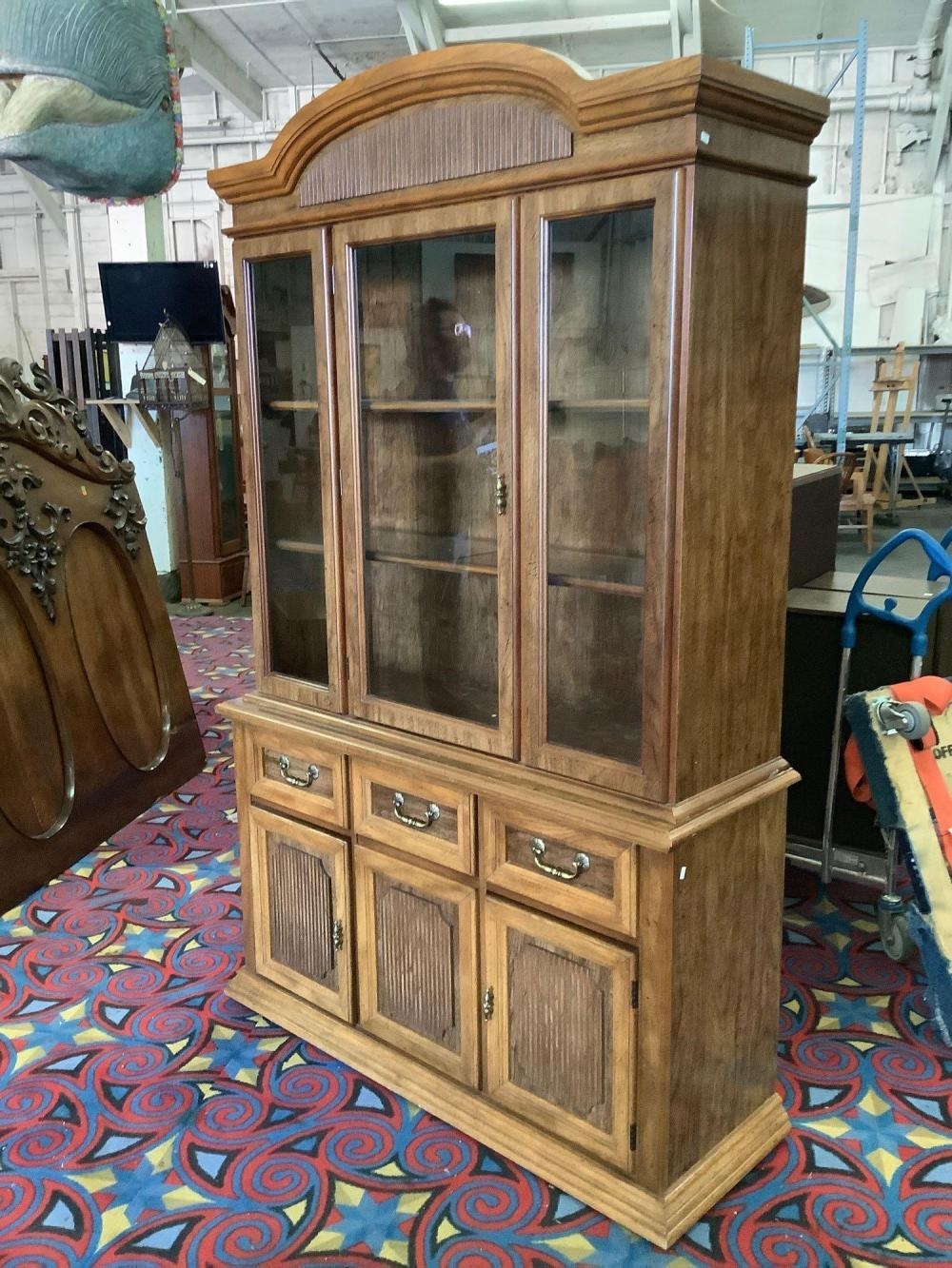 Lot 50: Modern Pecan china cabinet with glass windows/shelves, lighted top - marked Laconia