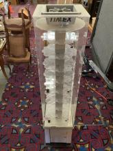 Lot 60: Timex store display rotating watch case, shows wear, lower storage door is off hinges