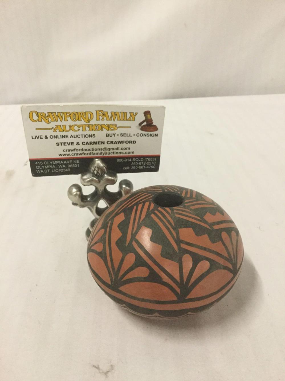 Lot 64: Ceramic seed pot with geometric designs by T. Sando of Jemez, New Mexico