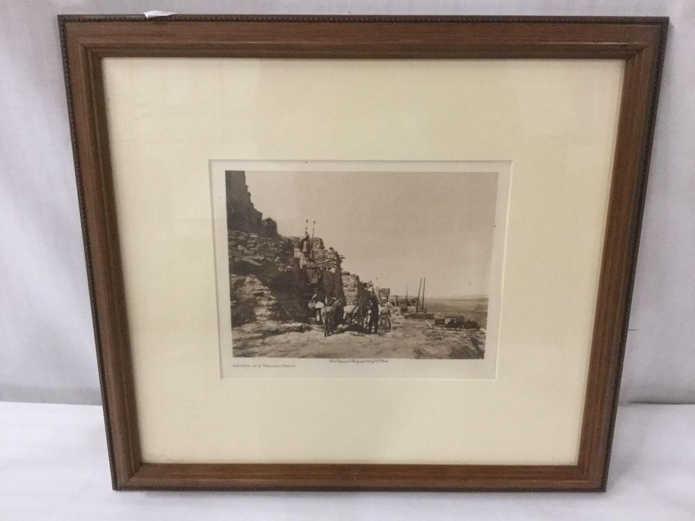 Lot 71: Antique framed photogravure by Edward Curtis (1868-1952) Return of the Trading Party - 1921