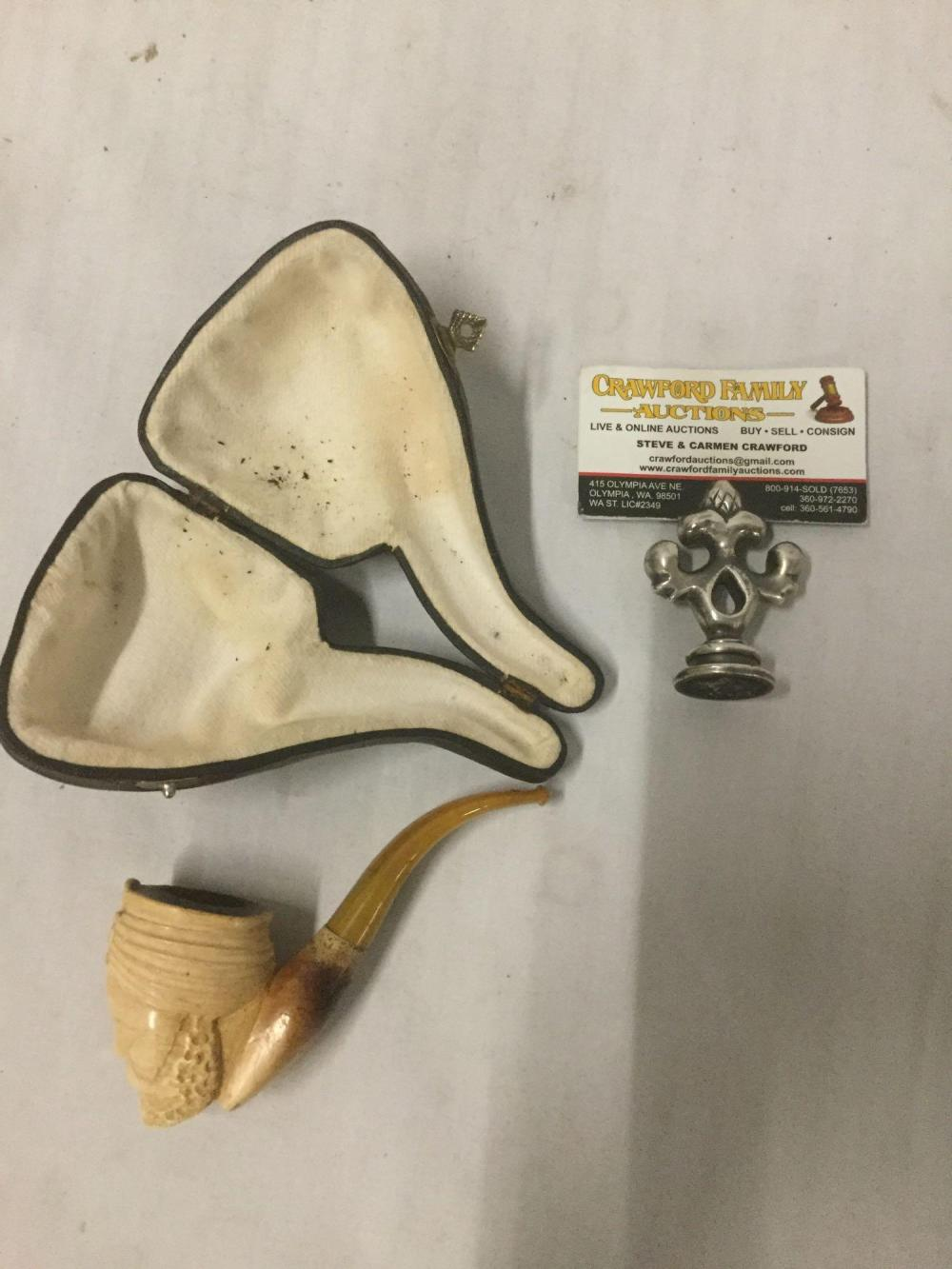 Lot 84: Ornate intricate vintage Meerschaum pipe with design of mans face in case