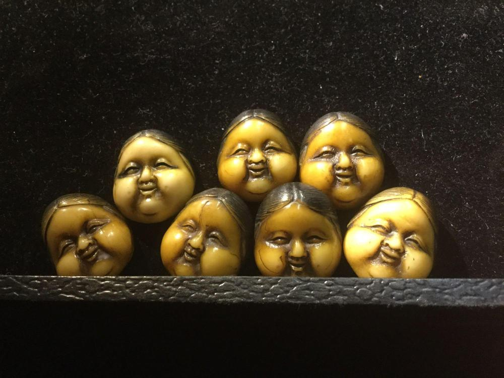 Collection of 7 Japanese Carved netsuke face beads - rare