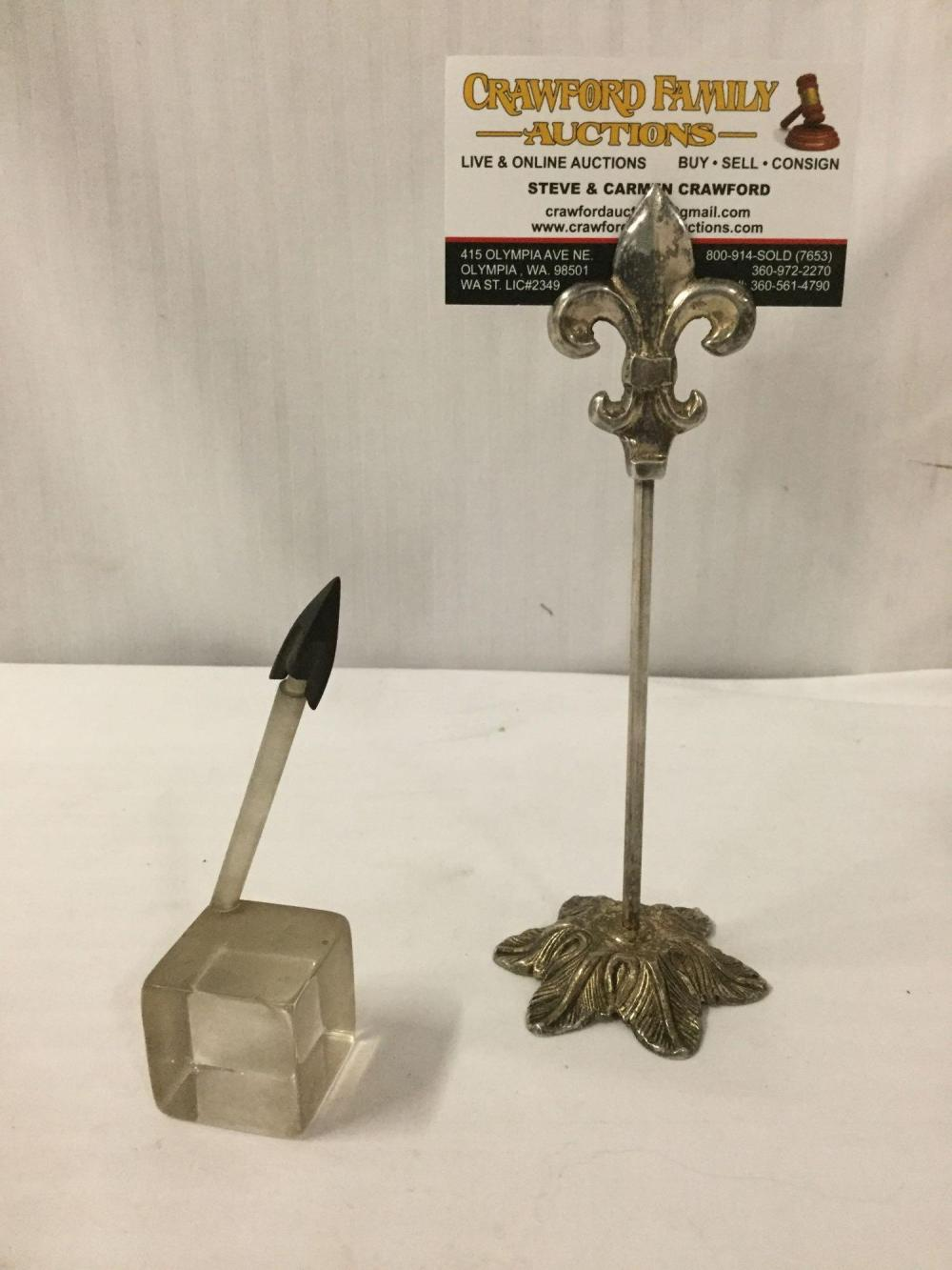 Antique Iron arrowhead having a raised mid-rib, includes plastic display stand