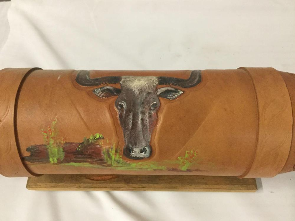 Lot 105: Set of Long Horns with wood mount and stamped leather accent with hand painted designs