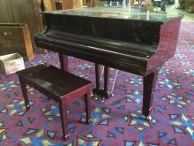 Lot 119: Wurlitzer baby grand piano with 2 tuning keys, original paperwork, piano bench