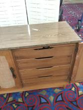 Lot 128: Mid Century 3 Drawer and one Cabinet Dresser with Nelsonized wood drawers -Has a laminate top