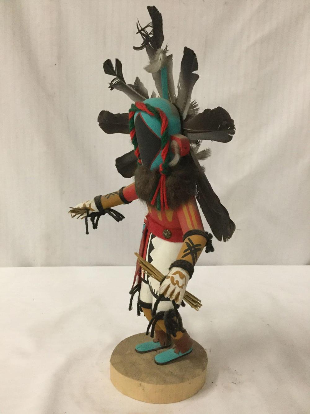 Lot 112: Native American art sculpture - Chasing Star - Hopi kachina doll, signed by artist J.F.T.