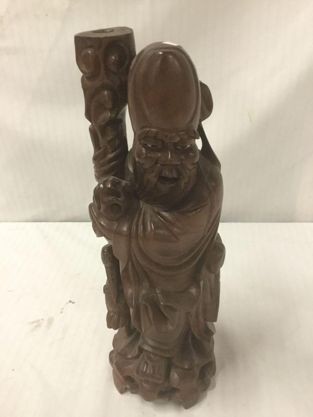 Lot 142: Vintage carved sage statue made from tropical hardwood