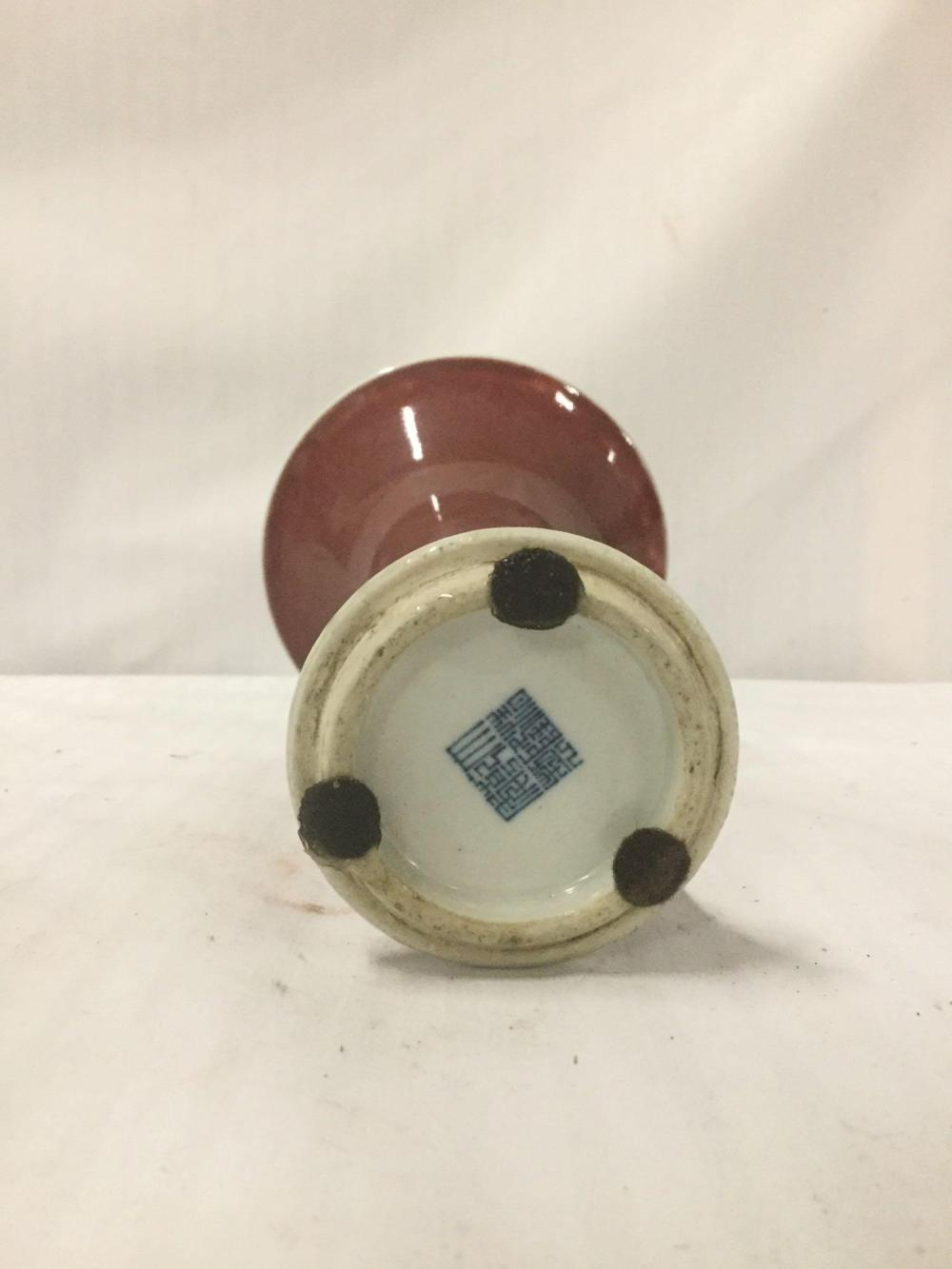 Lot 144: Oxblood Porcelain gu-Style vase with Apocryphal Qinlong Seal on the underside