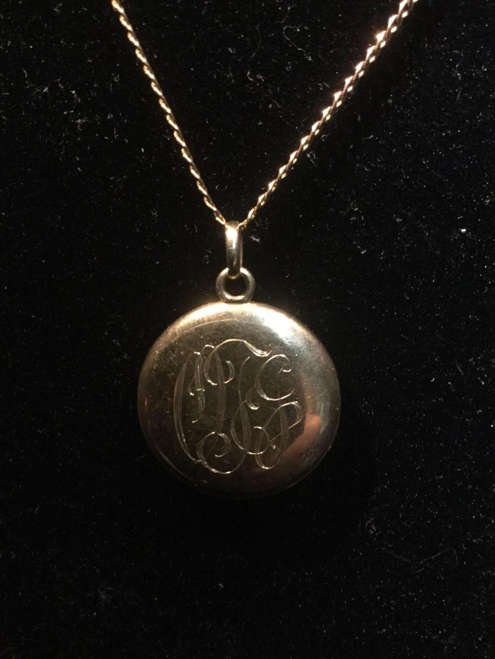 Lot 173: Vintage 14k gold monogrammed locket feat. a purple topaz stone set in back - 5 grams total