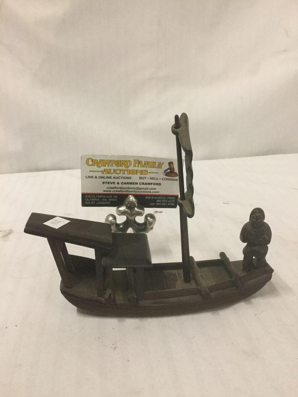 Lot 181: Vintage carved wood junk boat with affixed sailor - as is